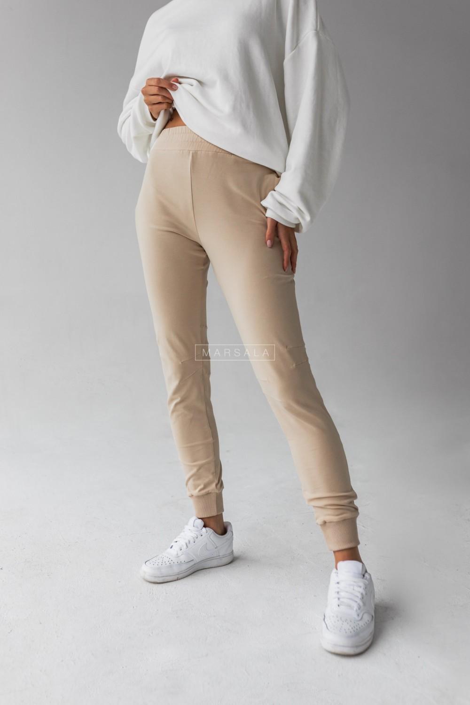 Spodnie dresowe z przeszyciami w kolorze beżowym SLENDER by Marsala