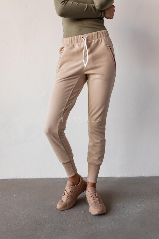 Spodnie dresowe w kolorze beżowym - ACTIVE BY MARSALA