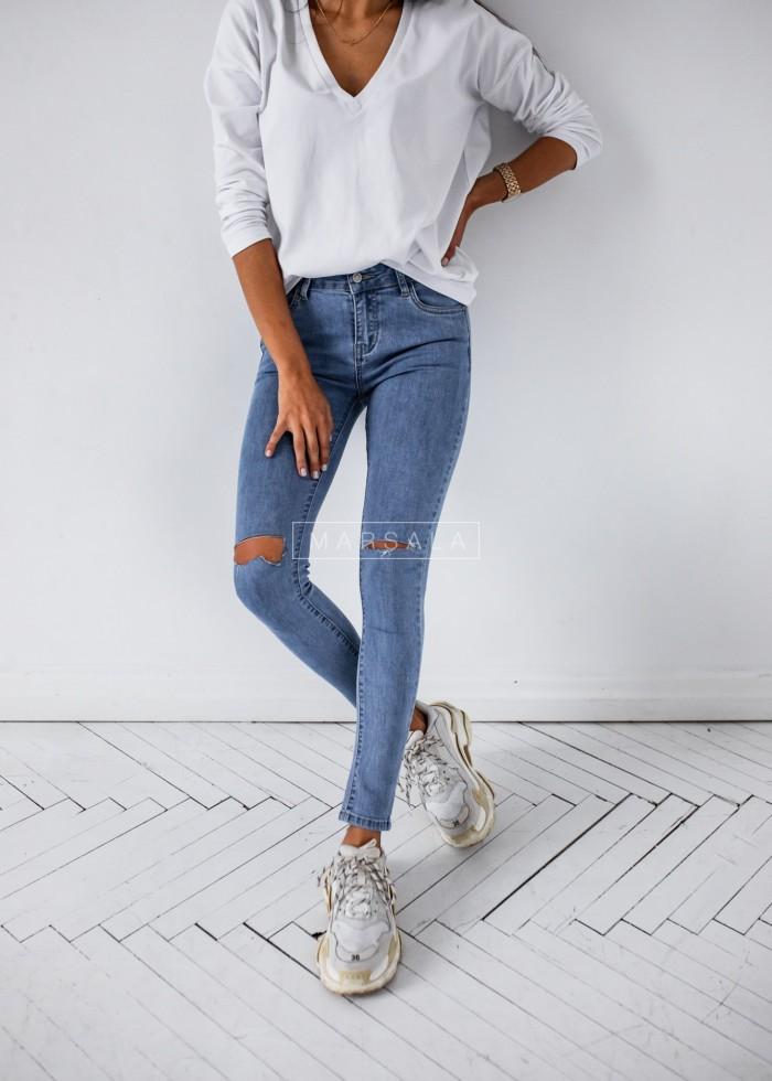 Spodnie jeansowe z rozcięciami na kolanach - SLASH